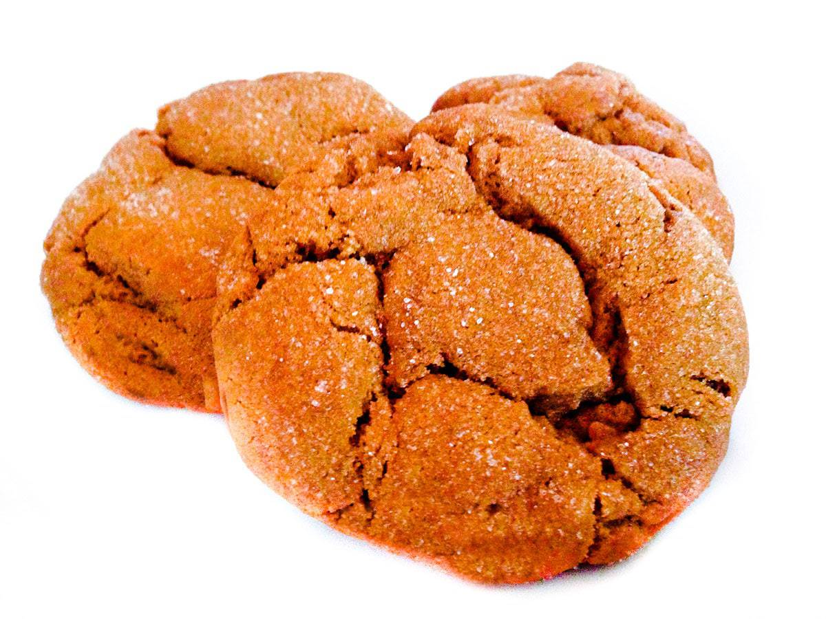 Three molasses cookies on a white background.