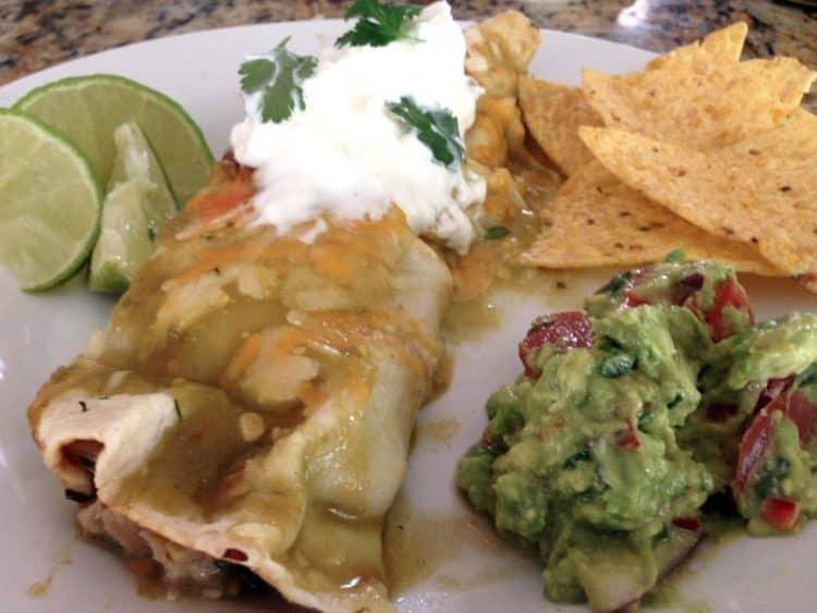 Serving of homemade chicken enchiladas