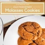 Plate of molasses cookies on a white plate with a rolling pin and the Mennoniter Community Cookbook