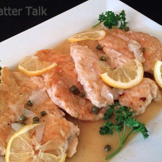 A plate of food with chicken piccata