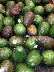 A pile of avocadoes