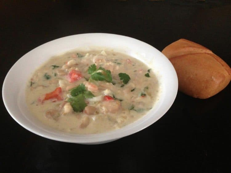 white chicken chil crock pot recipe is perfect with a loaf of rustic bread.