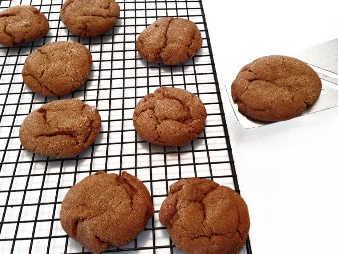 Molasses cookies on a cooling rack.
