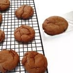 Molasses cookie on a cooling rack.