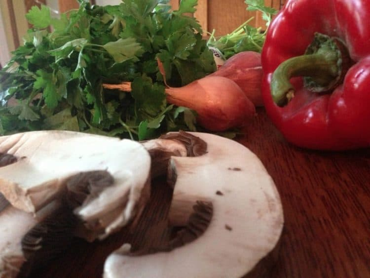 Mushrooms and other vegetables on a cutting board