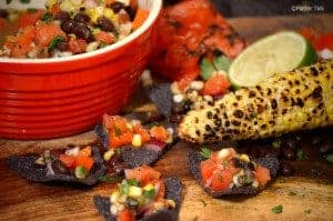 A close up of food on a table, with Platter and Salsa