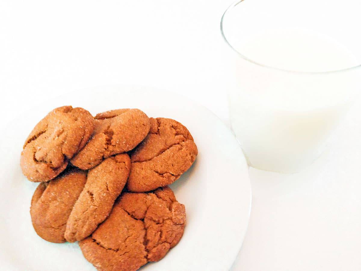 Plate of molasses cookies and a glass of milk.