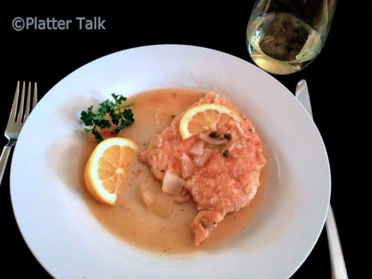 A plate of chicken piccata