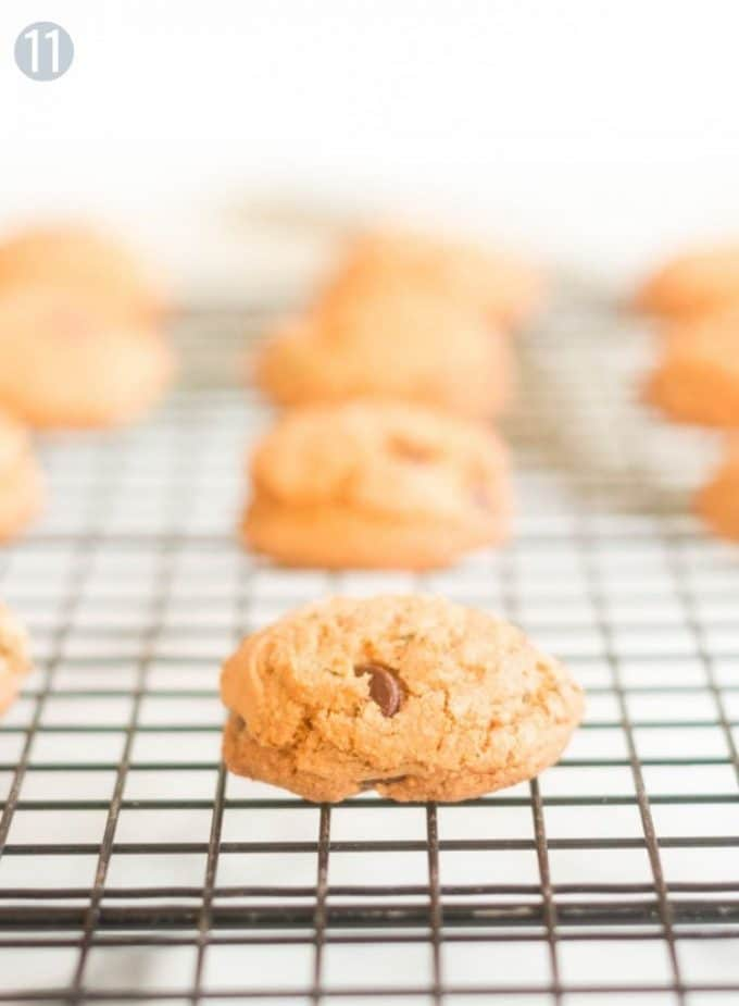 A close up of a cookie on a cooling rack