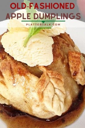 Apple dumpling on a plate with vanilla ice cream and fresh mint leaf.