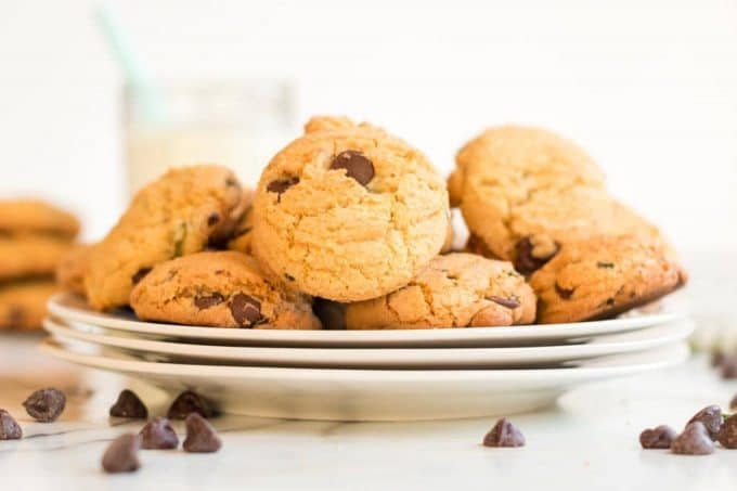 Plate of mint chocolate chip cookies garnished with chocolate chips.