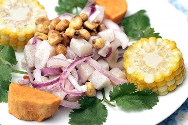 A plate of food, with Ceviche and Sweet potato