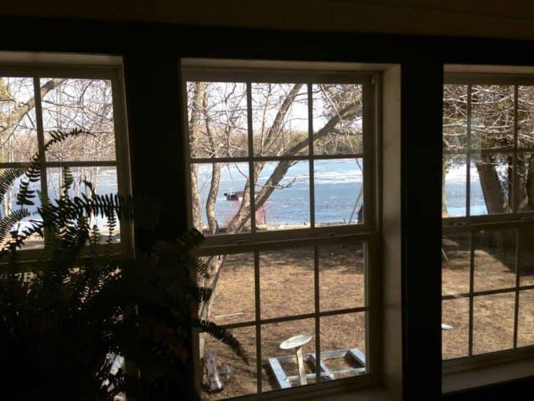 Looking through windows at a small lake.