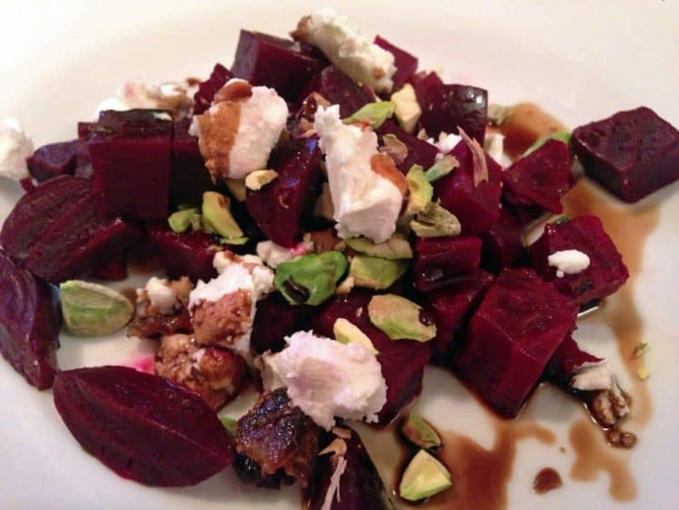 A plate of food with beet salad
