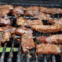 Strips of jerked beef on a grill