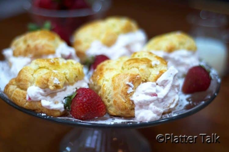 A plate of strawberry cream puffs