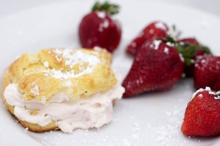 A closeup of food on a plate with strawberries