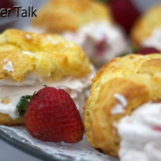 A close up of strawberry cream puffs
