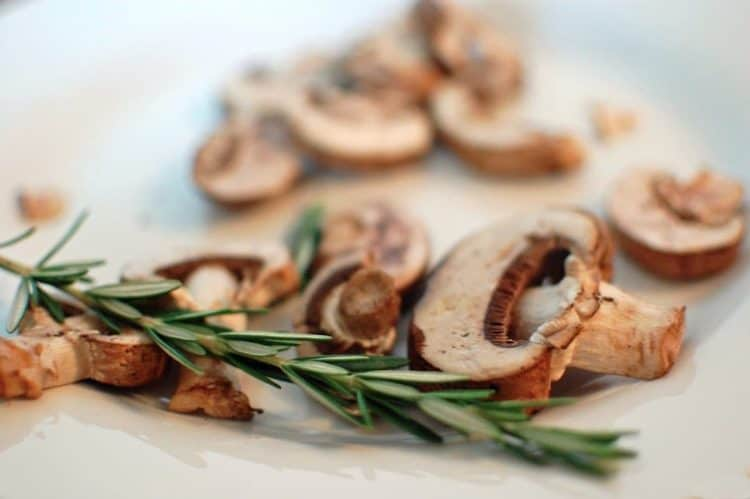 Fresh herbs are used to make sausage and mushroom pasta.