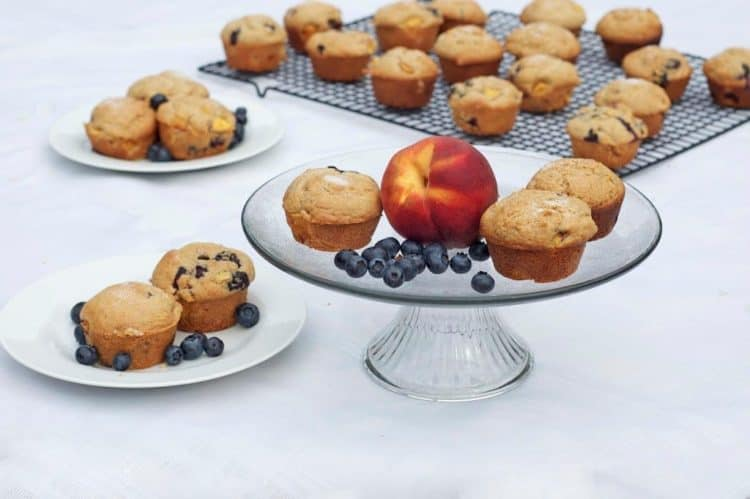 Muffins on a serving platter with a peach
