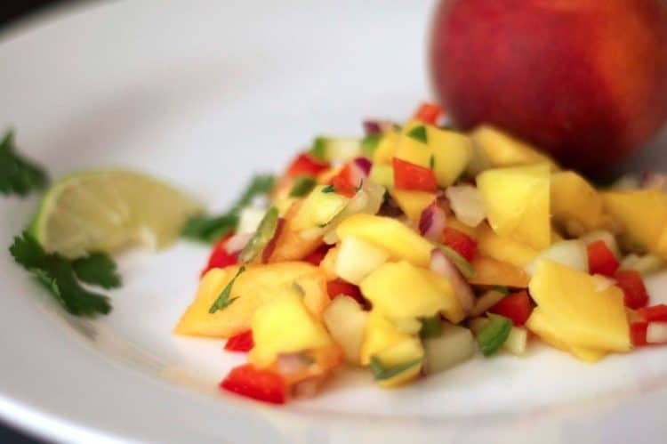 A plate of food, with Mango and Peach