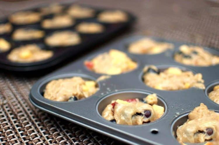 A muffin tray filled with batter
