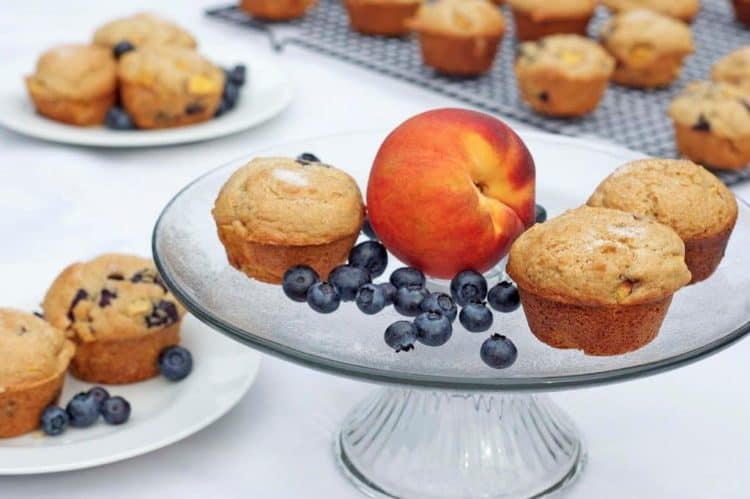 A plate of food on a table, with Peach and muffins