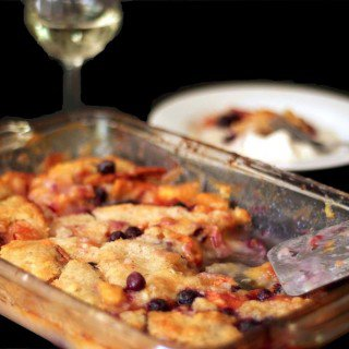 A baking dish filled with peach cobbler