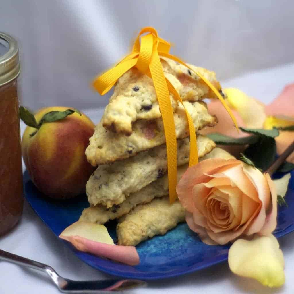 A stack of scones and a pink rose