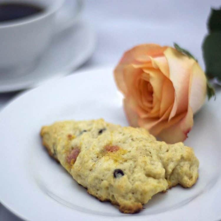 A scone and a rose on a plate