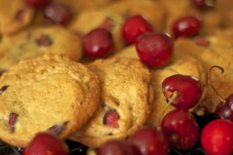 A plate of food with Cookie and Bing cherries