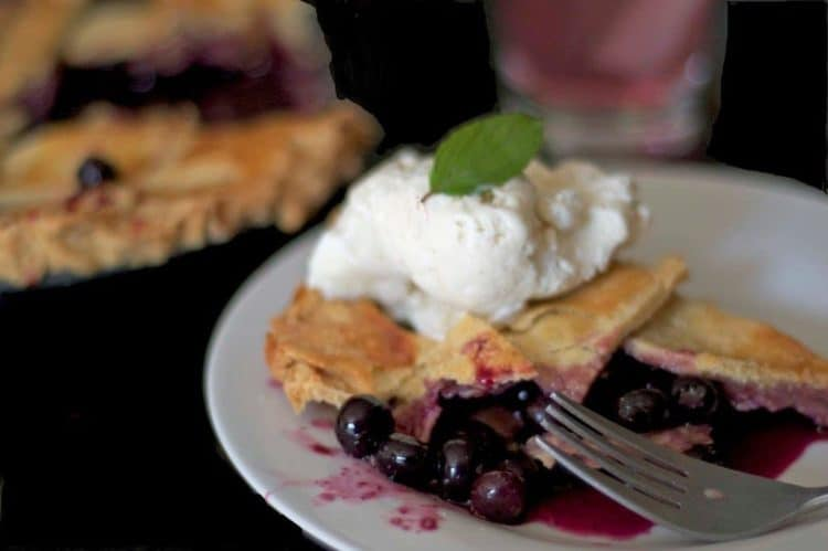 A slice of blueberry pie on a plate