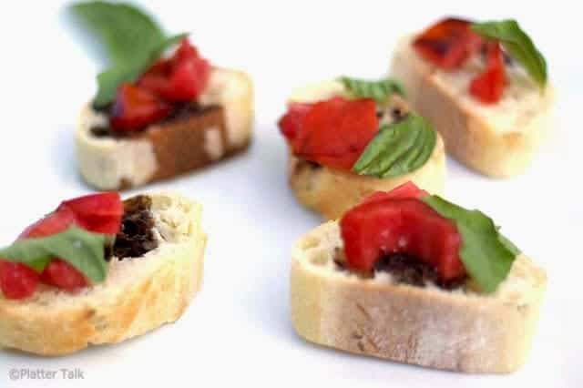 A piece of food, with bruschetta.