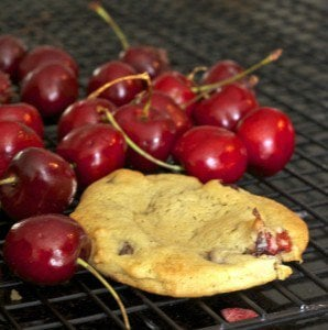 Bing cherries with a cookie on a cooling rack
