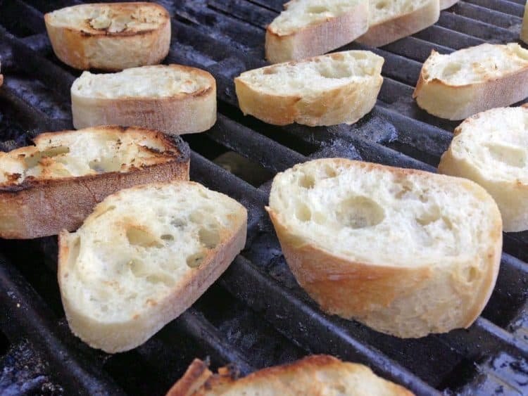 Some small pieces of bread on the grill.