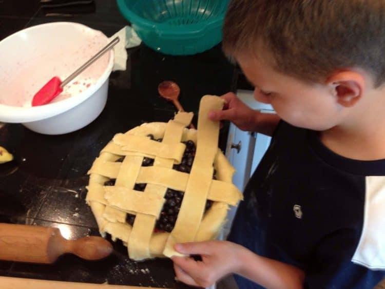 A boy making a pie