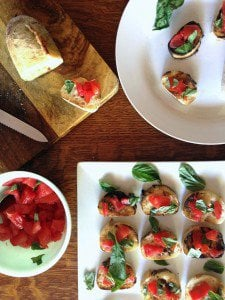A plate of food on a table, with Bruschetta.