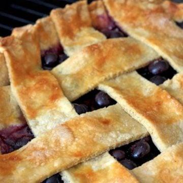 A close up of a blueberry pie