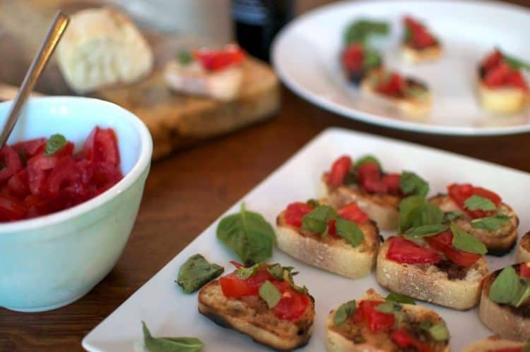 A close up of Bruschetta with tomatoes.