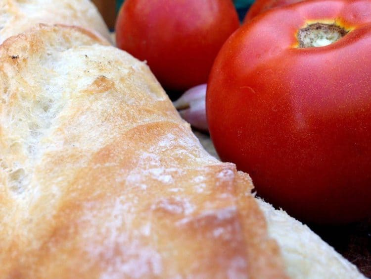 A loaf of bread with tomatoes.