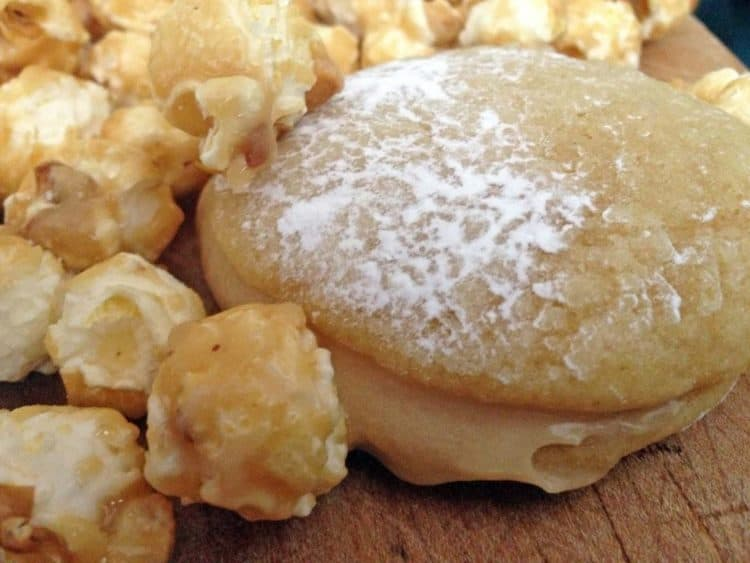 A whoopie pie surrounded by caramel corn.