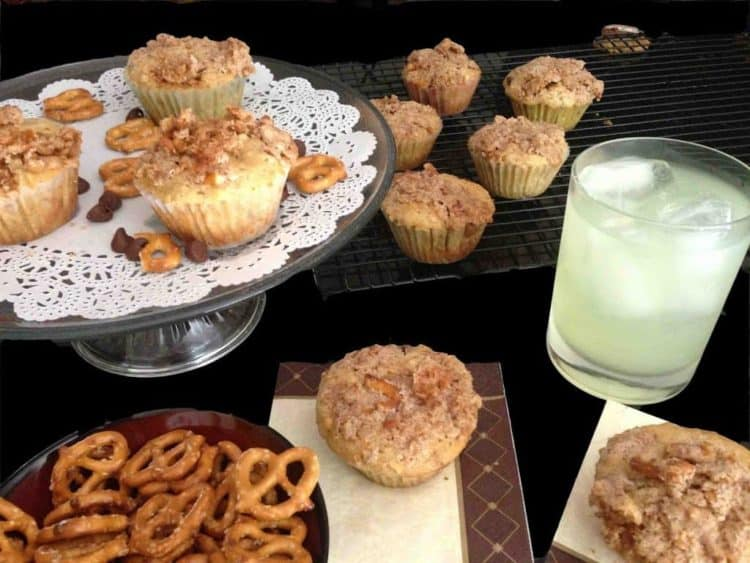 A bunch of pretzels muffins with milk.