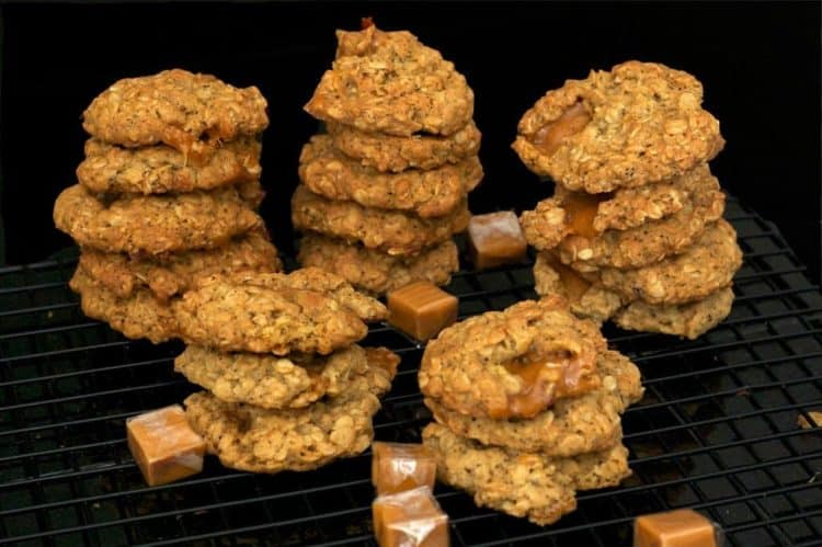 Some stacks of cookies on a cooking rack.