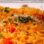 DIsh of tomato risotto with parmesan cheese.