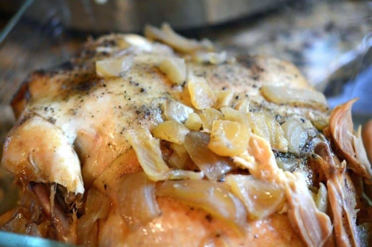 A close up of chicken and onions.