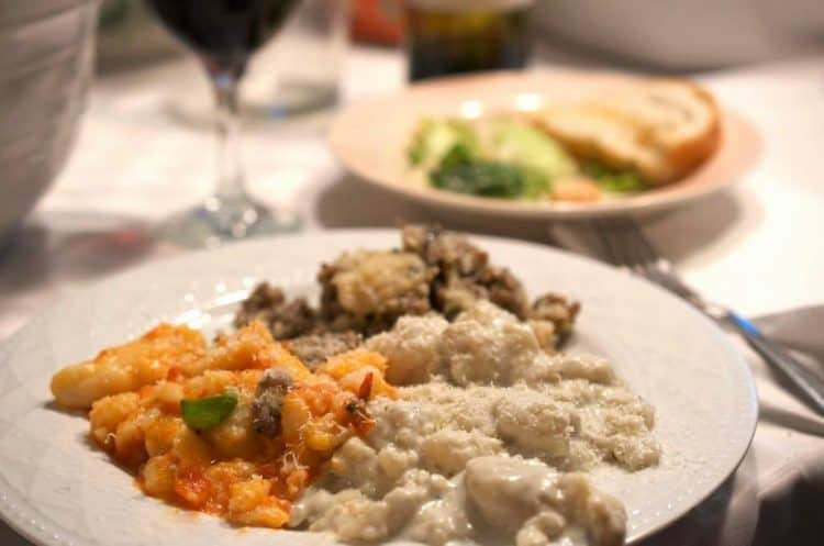 A plate of Gnocchi and vegetables.