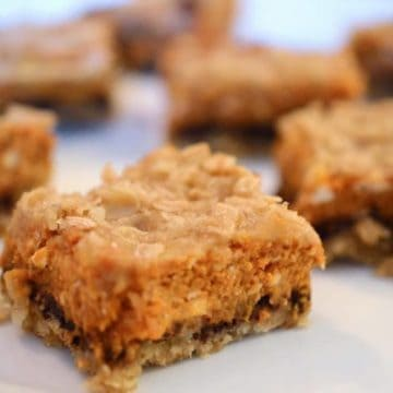 A close up of a piece of pumpkin cheese bars.