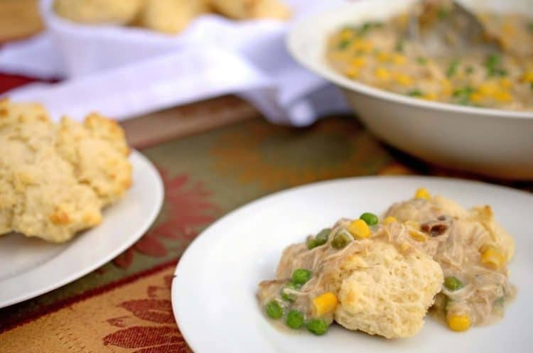 A plate of chicken and biscuits