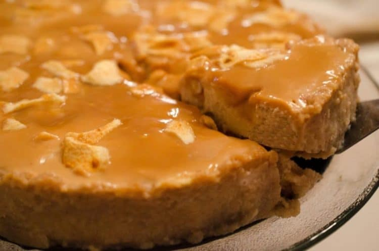 Slice of caramel apple cheesecake dessert recipe on plater talk.