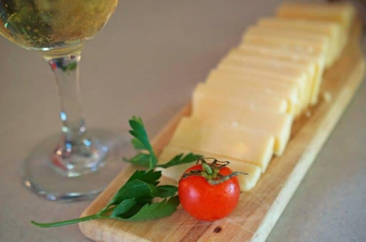 A plate of sliced cheese.